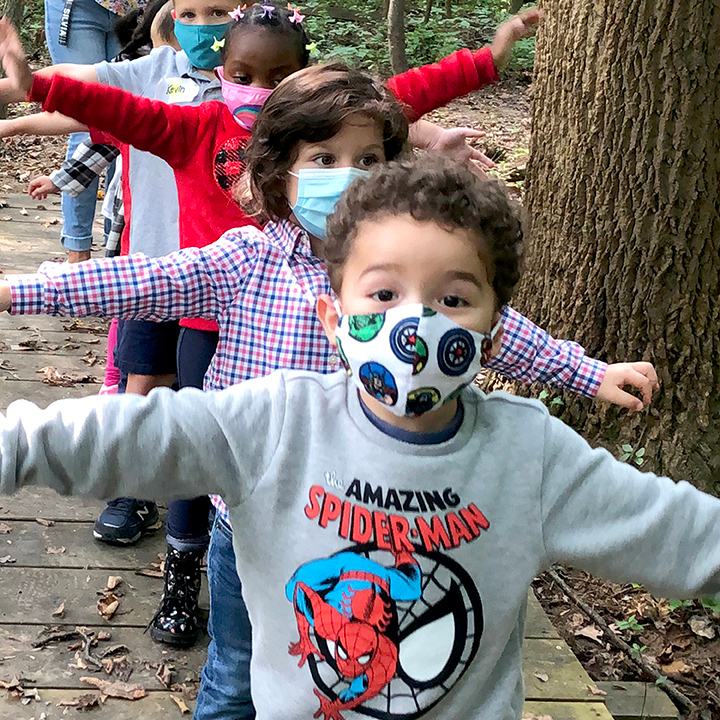 Preschoolers walking in woods