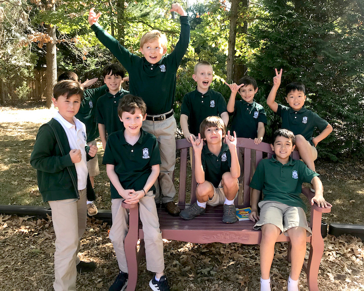 10 third-grade boys on bench outside