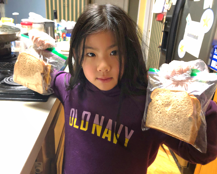 Student displays sandwiches she made for the hungry