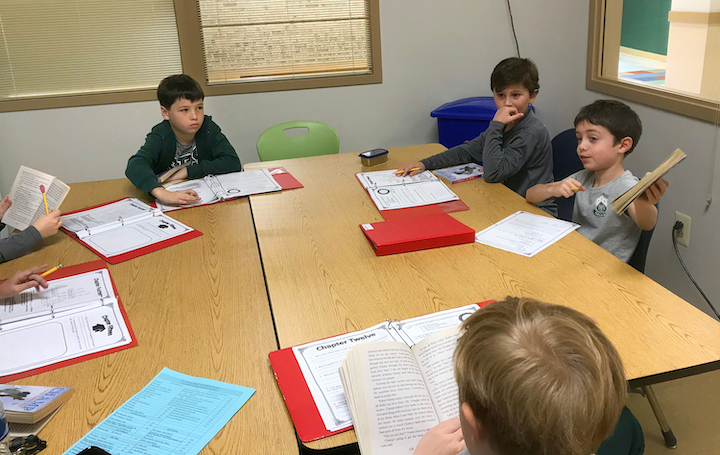 Six students at table in reading group