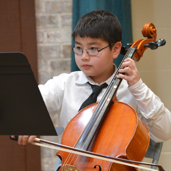 Student playing string instrument
