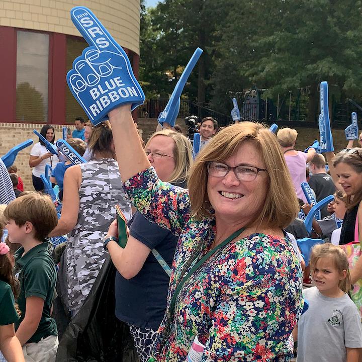 Teacher smiling at celebration