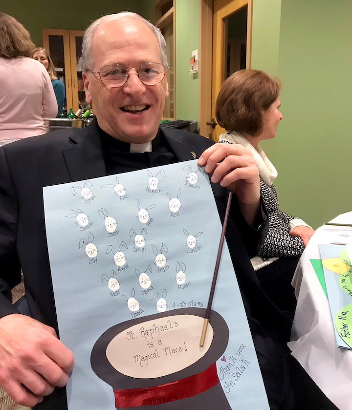 Priest displaying handmade card