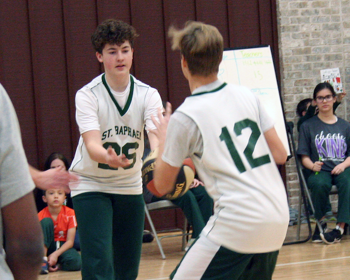 SRS students playing CYO basketball