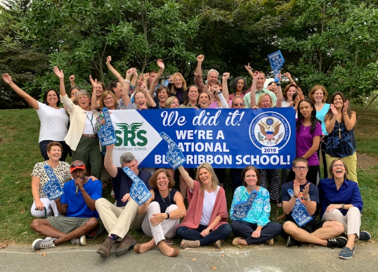 "Staff members cheering, with large banner saying, ""We did it! We're a National Blue Ribbon School!"""